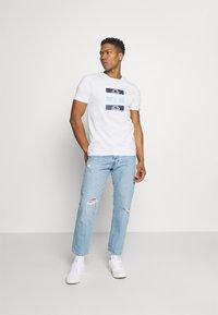 Ellesse - JACE - Print T-shirt - white - 1