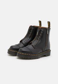Dr. Martens - 1460 LL BEX 8 EYE BOOT UNISEX - Classic ankle boots - black - 1