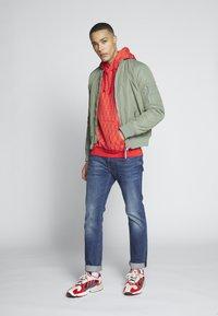 adidas Originals - GRAPHICS GRAPHIC HODDIE SWEAT - Hoodie - red/stiora - 1
