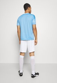 Puma - MANCHESTER CITY REPLICA - Träningsshorts - white/peacoat - 2