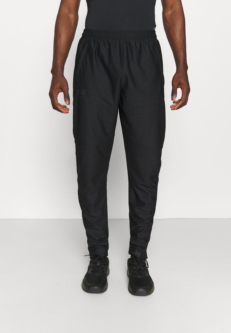 Under Armour - TRACK PANT - Teplákové kalhoty - black