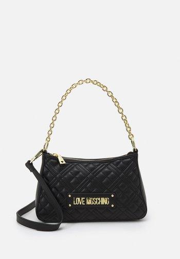 QUILTED POUCHETTE - Handbag - nero