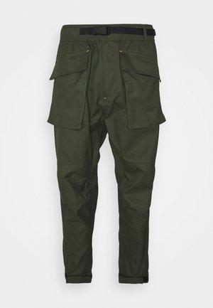 PANELED JOGGER - Cargo trousers - khaki