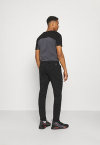 Replay - PANTS - Trousers - black - 2