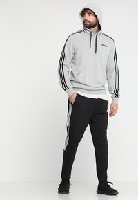 adidas Performance - MUST HAVES SPORT TIRO SLIM FIT PANT - Tracksuit bottoms - black/white - 1
