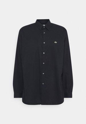Skjorta - abimes