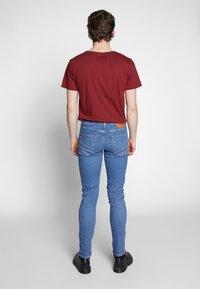 Levi's® - SKINNY TAPER - Jeansy Skinny Fit - blue denim - 2