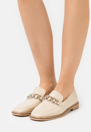 DIONETTE - Loaferit/pistokkaat - beige