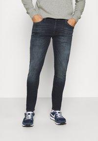 Jack & Jones - JJILIAM JJORIGINAL - Slim fit jeans - black denim - 0