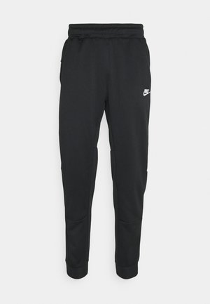 TRIBUTE - Tracksuit bottoms - black/white