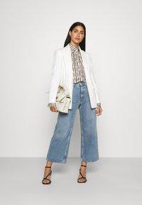 DRYKORN - CHARLAD - Button-down blouse - ecru - 1