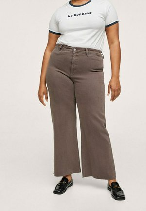 CATHERIN - Flared Jeans - donkergroen