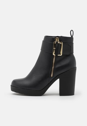 ABBA CHUNKY BUCKLE - Platform ankle boots - black