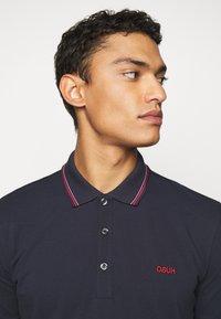 HUGO - DINOSO - Polo shirt - dark blue - 3