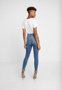 Topshop - JAGGED JAMIE - Jeans Skinny Fit - blue denim - 2