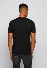 BOSS - TNOAH 1 - T-shirt imprimé - black - 2