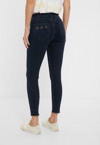 Desigual - JULIETA - Jeans slim fit - denim blue black - 2