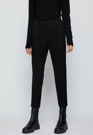 TERASY - Trousers - black