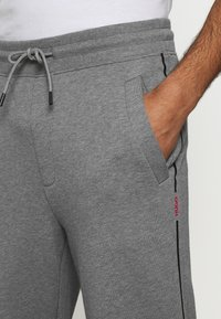 HUGO - DOAKY - Tracksuit bottoms - open grey - 5