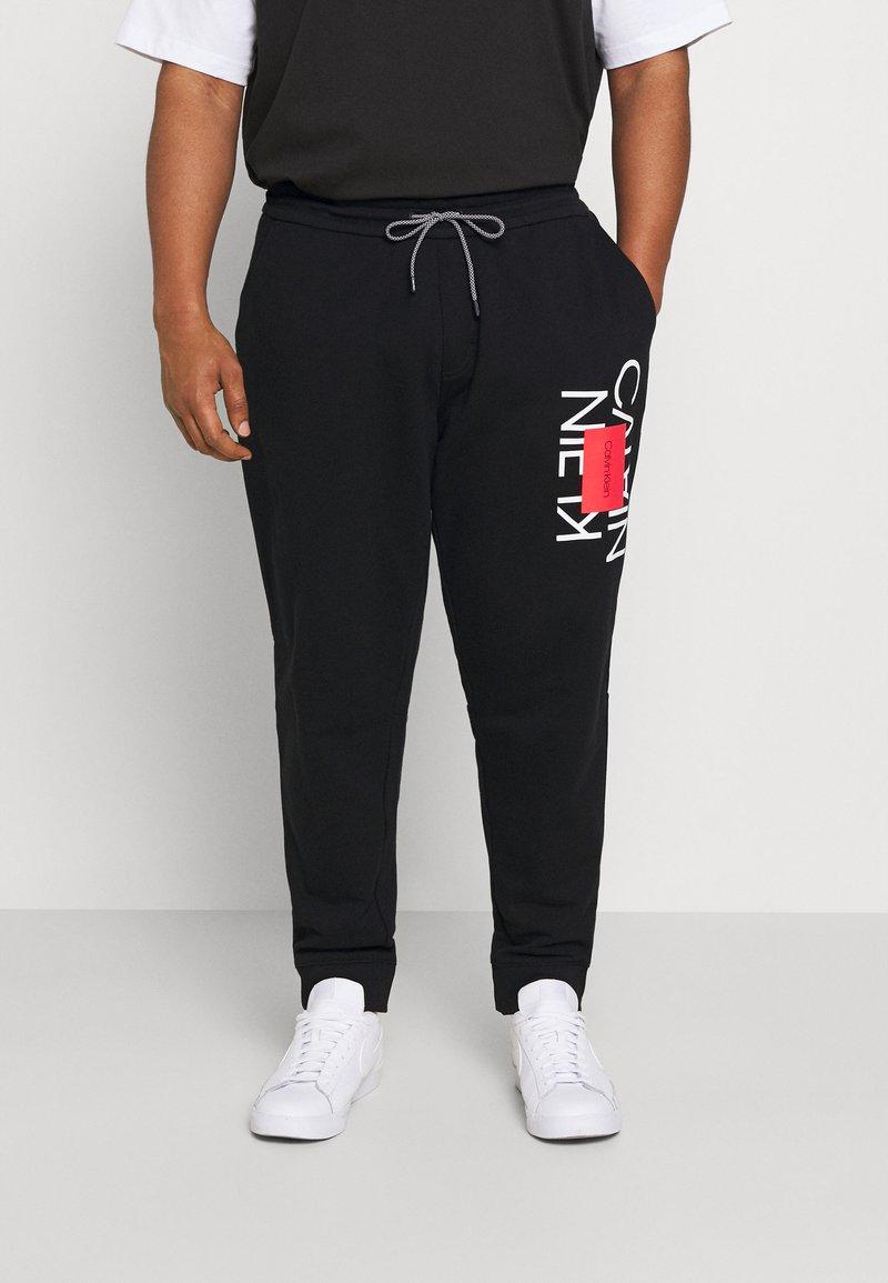 Calvin Klein - Träningsbyxor - ck black
