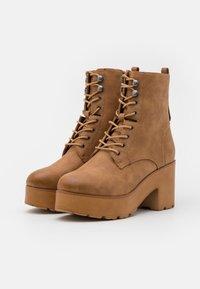 mtng - EMELINE - Šněrovací kotníkové boty - brown - 2