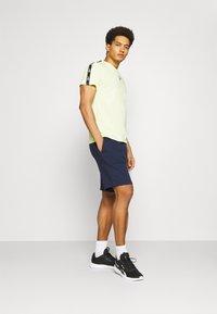Reebok - SHORT - Sports shorts - navy - 1