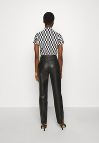 Freaky Nation - PANTS - Leather trousers - black - 2