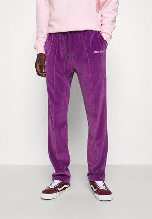 TRACK PANTS UNISEX - Tracksuit bottoms - purple