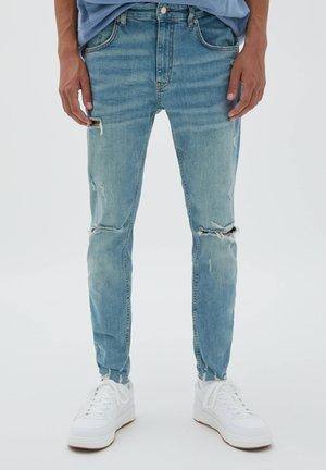 PREMIUM MIT RISSEN - Jeans Skinny Fit - blue denim