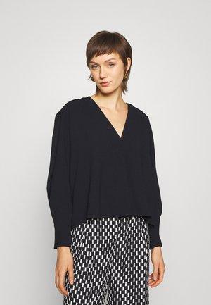 JANIC - Long sleeved top - black