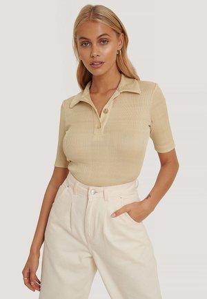 GERIPPT - Polo shirt - beige