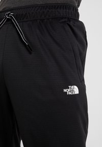 The North Face - LOGO JOGGER - Verryttelyhousut - black - 3