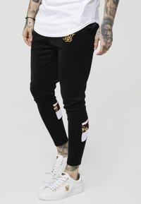 SIKSILK - ROYAL VENETIAN SPRINT TRACKSUIT PANTS - Pantalones deportivos - black/deep red - 0