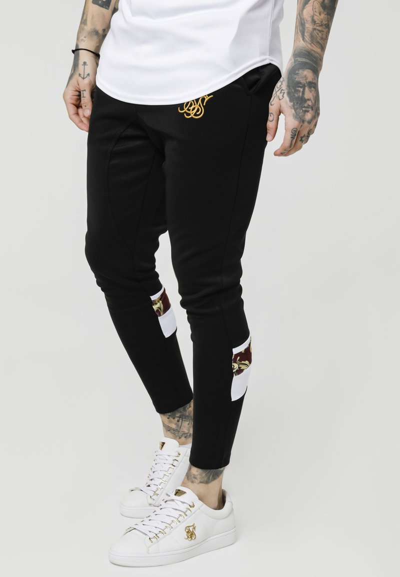 SIKSILK - ROYAL VENETIAN SPRINT TRACKSUIT PANTS - Pantalones deportivos - black/deep red