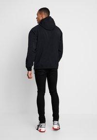 Nike Sportswear - Windbreaker - black - 2