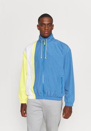 JACKET URBAN - Training jacket - bleu/blanc/jaune