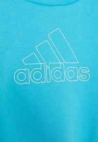 adidas Performance - Sweatshirt - brcyan/white - 3