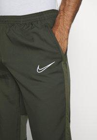 Nike Performance - DRY ACADEMY PANT - Tracksuit bottoms - cargo khaki/medium olive/white - 3