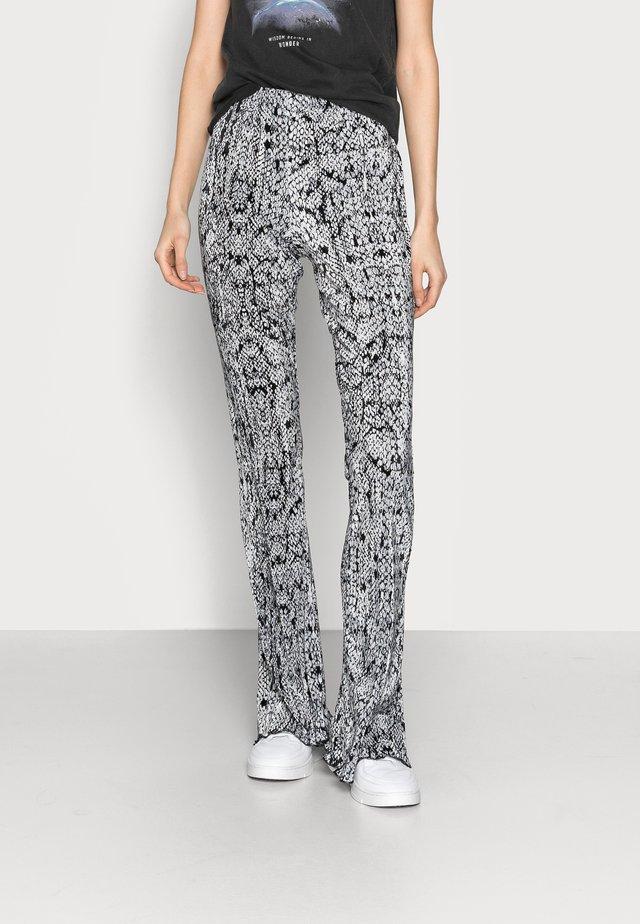 SNAKE FLARE - Spodnie materiałowe - multi