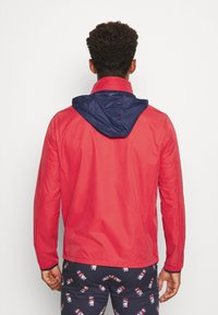 Polo Ralph Lauren Golf - HOOD ANORAK JACKET - Waterproof jacket - sunrise red - 2