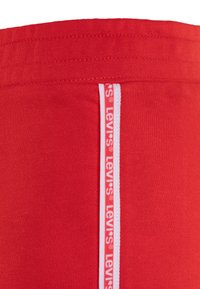 Levi's® - LOUNGE SHORTY - Tracksuit bottoms - tomato red - 2