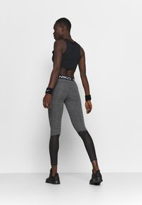 Nike Performance - Leggings - black/heather/white - 2