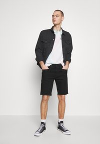 Levi's® - TAPER - Denim shorts - eight ball - 1
