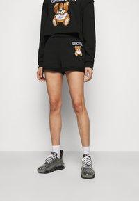 MOSCHINO - TROUSERS - Shorts - black - 0
