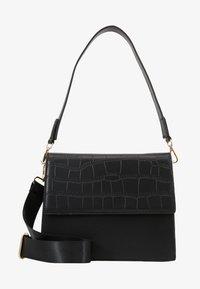 CHRIS CROSS BODY - Handbag - black/gold