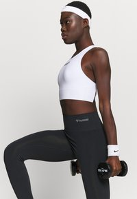 Hummel - SEAMLESS HIGH WAIST  - Trikoot - black