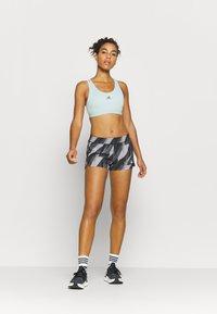 adidas Performance - PACER - Sports shorts - black - 1