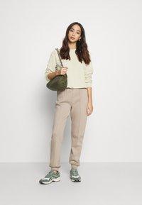 NA-KD - CROPPED DRAWSTRING - Sweatshirt - beige - 1