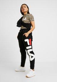 Fila Petite - PUREPANTS - Spodnie treningowe - black - 2
