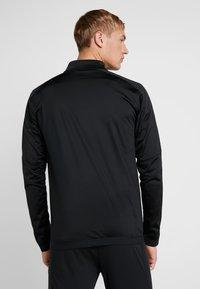 Puma - MANCHESTER CITY STADIUM JACKET - Klubbkläder - black/georgia peach - 2